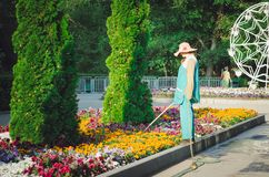 Gorky Park. A park employee watering flowers from a hose. Every morning in this park, workers royalty free stock image
