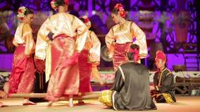 SARAWAK, MALAYSIA - JUNE 2012: Iban and Malay tribal performance stock video footage