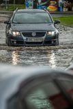 Car on a flooded street Royalty Free Stock Images