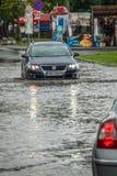Car on a flooded street Royalty Free Stock Photos
