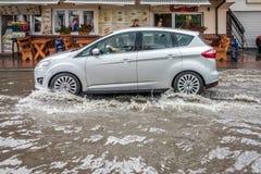 Car on a flooded street Stock Photos