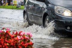 Car on a flooded street stock photo