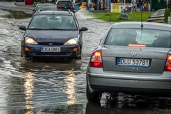Cars on a flooded street stock photo
