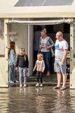 Family looking at an aftermath of torrential rain Stock Photos
