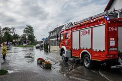 Firetruck arriving to drain flooded area Royalty Free Stock Photo