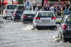 Cars on a flooded street royalty free stock photo