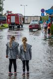 Two sisters looking at an aftermath of torrential rain Stock Image