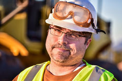 Sarcastic Construction Worker. Construction worker on site looking very sarcastic Royalty Free Stock Photo