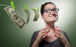 Sarcastic girl dreams of many money. Concept total greed Stock Images