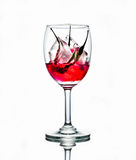 Sarcastic ice chilli in liquid. Chilli in ice cube in some liquid and in wine glass that have alot of meaning Stock Images