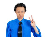 Sarcastic man giving victory sign Stock Images