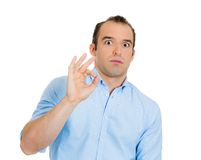 Sarcastic man showing ok sign Stock Images