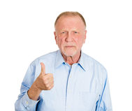Sarcastic old guy showing thumbs up sign Stock Image