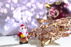 SARCASTIC SANTA CLAUS. CHRISTMAS DECOR ORNAMENT. MERRY CHRISTMAS. DECORATIVE ELEMENTS OVERHEAD PHOTO. BEAUTYFUL ORNAMENT TOOLS STILL LIFE. ISOLATED WHITE Royalty Free Stock Images