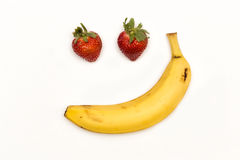 The Sarcastic Smile. Strawberries and banana forming a sarcastic smile Royalty Free Stock Photo