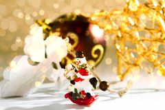 SARCASTIC SNOWMAN. CHRISTMAS DECOR ORNAMENT. MERRY CHRISTMAS. DECORATIVE ELEMENTS PHOTO. BEAUTYFUL ORNAMENT TOOLS STILL LIFE. ISOLATED WHITE BACKGROUND. FOR Royalty Free Stock Photo