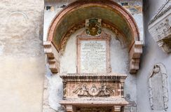 Sarcophagus of the Abati - Sarcofago degli Abati - on the external façade of the little church of Sant`Apollinare, Trento, Trent. Ino Alto Adige, Italy stock photo