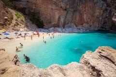 SARDEGNA, ITALY - 24 June 2016: People on the beatiful beach Cala Mariolu bay, BAUNEI, SARDEGNA. People on the beatiful beach Cala Mariolu bay, BAUNEI, SARDEGNA stock photography