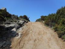 Mediterranean. Sardegna road sand sea royalty free stock image