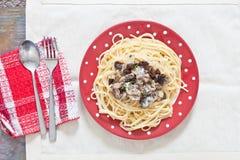 Sardinas y espaguetis Imágenes de archivo libres de regalías