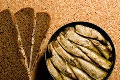 Sardinas y pan Foto de archivo libre de regalías
