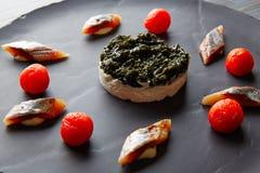 Sardine with pannacotta codium and tomato. Bota sardine with white garlic pannacotta, codium and osmotized tomatoes Stock Images