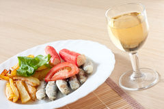 Sardine salad and wine healthy food Royalty Free Stock Images
