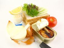 Sardine Sandwich in the making. Served with mayonaise on white back ground Royalty Free Stock Image
