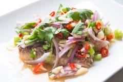 Sardine spicy salad or yum sardine. Mixture of red chili, garlic scallion, cilantro red onion lime juice over sardine. Yum is a  Thai style spicy salad Stock Photo