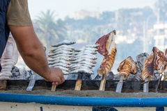 Sardine and squid skewers. On the beach Stock Image