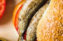 Sardines in burger closeup Royalty Free Stock Photography