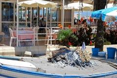 Sardines cooking at a beach bar, Fuengirola. Royalty Free Stock Images