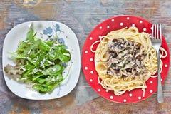 Sardines et spaghetti Photographie stock libre de droits
