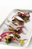 Sardines with grapes and red onion Stock Photos