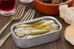 Sardines in iron box on brown background Stock Photo