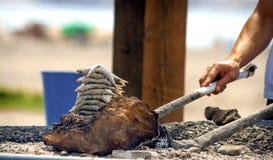 Sardines op een vleespenbrandhout bij het strand in Malaga, Spanje Royalty-vrije Stock Foto