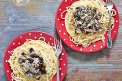 Sardines and spaghetti Stock Images