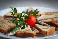 Sardines and toasted whole grain bread Stock Photos