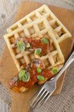 Sardines with tomato sauce and waffle Stock Photo