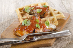 Sardines with tomato sauce and waffle Stock Image