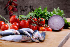 Sardines with various ingredients Royalty Free Stock Images