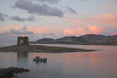 Sardinia. La Pelosa tower and Asinara Island at sunset, Stintino, Sardinia, Italy stock photography
