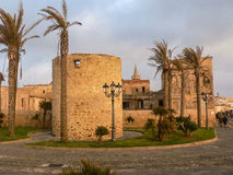 Sardinia. Alghero - L'Alguer. View of the old town in the sunset light. The ancient ramparts and the tower named La Polvorera (powder keg Stock Image