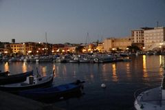Sardinia. Ancient Coastal Towns. Portoscuso. After the sunset in the fishing and touristic port of Portoscuso, in southwestern Sardinia stock video
