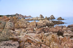 Sardinia beach. Beach made mostly of rocks in Calarossa, Sardinia, Italy stock images