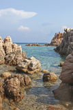 Sardinia beach. Beach made mostly of rocks in Calarossa, Sardinia, Italy Royalty Free Stock Images