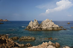 Sardinia beach. Beach made mostly of rocks in Calarossa, Sardinia, Italy Royalty Free Stock Photos