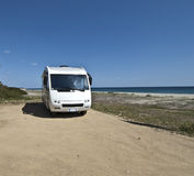 Sardinia camper. Camper parked on a beach in Sardinia royalty free stock photos