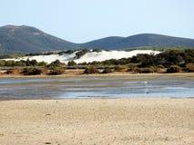 Italy, Sardinia, Carbonia Iglesias, Porto Pino, the pond behind the white sand dunes. Sardinia, Carbonia Iglesias, Porto Pino, the pond behind the white sand Royalty Free Stock Images
