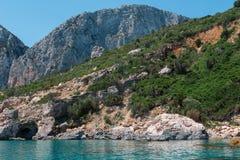 Sardinia Coastline: Majestic Rock near Sea, Italy Stock Images